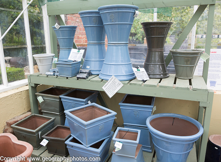 Display of terracotta pots on sale, The Walled garden plant nursery, Benhall, Suffolk, England, UK
