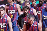 FC Barcelona Regal's Xabi Rabaseda, Victor Sada and Sarunas Jasikevicius dejected after Liga Endesa ACB match.January 13,2012. (ALTERPHOTOS/Acero)