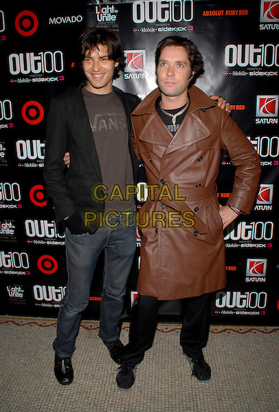 "RUFUS WAINWRIGHT & GUEST.""Out""Magazine honors 100 most influential people in gay culture during ""Out 100 Awards"" at Capitale, New York, NY, USA, 10 November 2006..full length brown leather belted trench coat .Ref: ADM/PH.www.capitalpictures.com.sales@capitalpictures.com.©Paul Hawthorne/AdMedia/Capital Pictures. *** Local Caption ***"