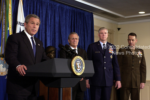 United States President George W. Bush makes a statement to the press in the Pentagon on May 10, 2004, as US Secretary of Defense Donald H. Rumsfeld, Chairman of the Joint Chiefs of Staff General Richard B. Myers and Vice Chairman of the Joint Chiefs of Staff General Pete Pace look on.  <br /> Mandatory Credit: Jerry Morrison / DoD via CNP