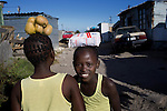 GUGULETU, SOUTH AFRICA - MARCH 12: Girls carry food on their heads on December 12, 2014, In the Barcelona section of Guguletu, a township outside Cape Town, South Africa. Guguletu is one of the biggest black townships in Cape Town (Photo by Per-Anders Pettersson)