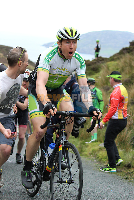 Johnny Clarke Meath Navan Road Club receives a welcome hand on the first Cat 1 climb Mamore Gap during Stage 4 of the 2017 An Post Ras running 151.8km from Bundoran to Buncrana, Ireland. 24th May 2017.<br /> Picture: Andy Brady | Cyclefile<br /> <br /> <br /> All photos usage must carry mandatory copyright credit (&copy; Cyclefile | Andy Brady)