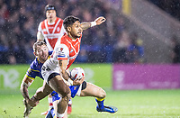 Picture by Allan McKenzie/SWpix.com - 09/03/2018 - Rugby League - Betfred Super League - Warrington Wolves v St Helens - Halliwell Jones Stadium, Warrington, England - St Helens' Ben Barba offloads as he's tackled by Warrington's Daryl Clark.