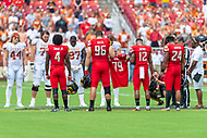 Landover, MD - September 1, 2018: Maryland Terrapins players hold up fallen teammate Jordan McNair's jersey during coin toss before Maryland and No. 23 ranked Texas at FedEx Field in Landover, MD. The Terrapins upset the Longhorns in back to back season openers with a 34-29 win. (Photo by Phillip Peters/Media Images International)