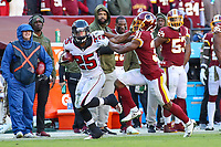 Landover, MD - November 4, 2018: Atlanta Falcons running back Ito Smith (25) stiff arms Washington Redskins cornerback Fabian Moreau (31) during the  game between Atlanta Falcons and Washington Redskins at FedEx Field in Landover, MD.   (Photo by Elliott Brown/Media Images International)