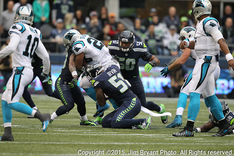 Seattle Seahawks  free safety Earl Thomas (29) and linebacker Bruce Irvin (51) tackles Carolina Panthers  running back Jonathan Stewart (28) at CenturyLink Field in Seattle on October 18, 2015. The Panthers came from behind with 32 seconds remaining in the 4th Quarter to beat the Seahawks 27-23.  ©2015 Jim Bryant Photography. All Rights Reserved.