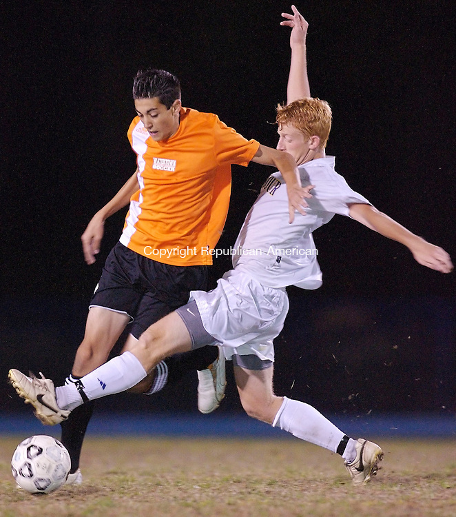 SEYMOUR, CT--02 October 07--100207TJ09 - Seymour's Jeff Disbrow, right, tries to steal the ball from Watertown's Andrew Ferrucci during Seymour High School's 6-1 win against Watertown High School in Seymour, Conn., on Tuesday, October 2, 2007. T.J. Kirkpatrick/Republican-American