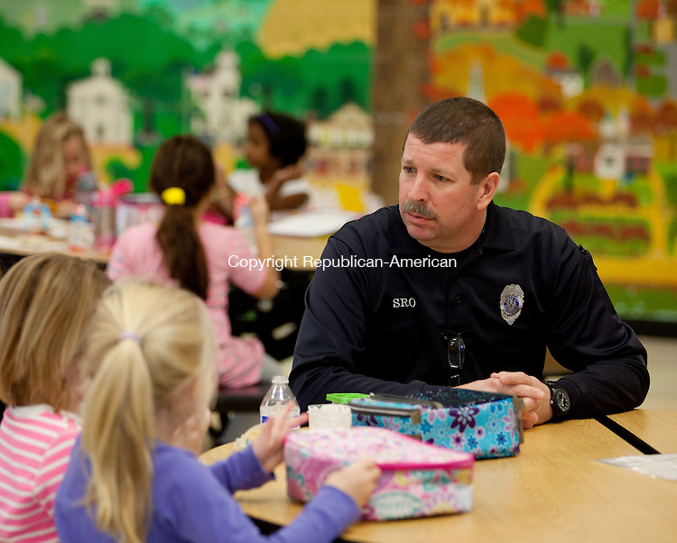 WOODBURY, CT-13 November 2013-111313BF04- School Resource Officer Craig Tibbals checks safety and visits with students and teachers daily at Mitchell Elementary School in Woodbury. Officer Craig, as he is known to students, started as the school resource officer at the school in September and is at the school each day students are present. Bob Falcetti Republican-American