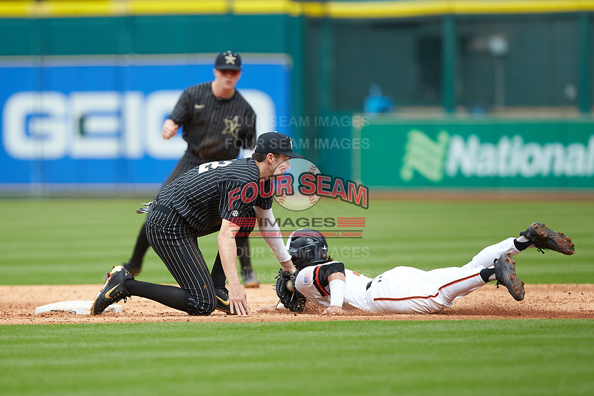 Andrew Fregia (7) of the Sam Houston State Bearkats is tagged out by Vanderbilt Commodores shortstop Connor Kaiser (12) as he attempts to steal second base in game one of the 2018 Shriners Hospitals for Children College Classic at Minute Maid Park on March 2, 2018 in Houston, Texas. The Bearkats walked-off the Commodores 7-6 in 10 innings.   (Brian Westerholt/Four Seam Images)