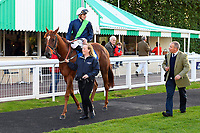 Winner of The Excalibur Communications EBF Fillies' Novice Stakes Swift and Sure ridden by Hector Crouch and trained by Clive Cox is led into the winners enclosure  during Twilight Racing at Salisbury Racecourse on 14th September 2018