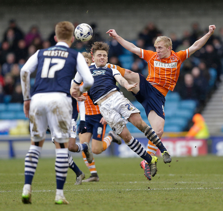 Blackpool's Mark Cullen battles for possession with Millwall's Ben Thompson<br /> <br /> Photographer Craig Mercer/CameraSport<br /> <br /> Football - The Football League Sky Bet League One - Millwall v Blackpool - Saturday 5th March 2016 - The Den - Millwall<br /> <br /> &copy; CameraSport - 43 Linden Ave. Countesthorpe. Leicester. England. LE8 5PG - Tel: +44 (0) 116 277 4147 - admin@camerasport.com - www.camerasport.com