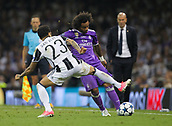 June 3rd 2017, National Stadium of Wales , Wales; UEFA Champions League Final, Juventus FC versus Real Madrid; Marcelo of Real Madrid and Dani Alves of Juventus challenge for the ball during the match