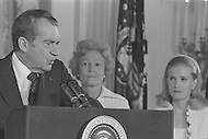 President Richard Nixon (with wife Pat and daughter Tricia) Resignation At White House In Washington On August 9th 1974 - A break in at the Democratic National Committee headquarters at the Watergate complex on June 17, 1972 results in one of the biggest political scandals the US government has ever seen.  Effects of the scandal ultimately led to the resignation of  President Richard Nixon, on August 9, 1974, the first and only resignation of any U.S. President.