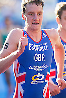 20 JUL 2013 - HAMBURG, GER - Alistair Brownlee (GBR) of Great Britain begins his first run lap during the elite men's ITU 2013 World Triathlon Series round in the Altstadt Quarter in Hamburg, Germany (PHOTO COPYRIGHT © 2013 NIGEL FARROW, ALL RIGHTS RESERVED)