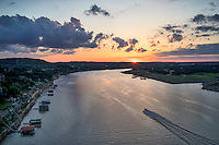 This is a section of the lake we live on and it is our first capture of an aerial sunset over Lake Travis using our new DJI-S900 with the Sony A7R 36 mg pixel camera.  It did what we hoped gave us high quality images. You can see the boat racing toward the sunset and the boat docks not as far down as they were just two days ago since the lake rose by about 8ft over night.  We have had to wait because the sun has been in hiding for a while now so this was our first chance to capture a sunset.  Of course another round of rain and dark skies are headed our way.