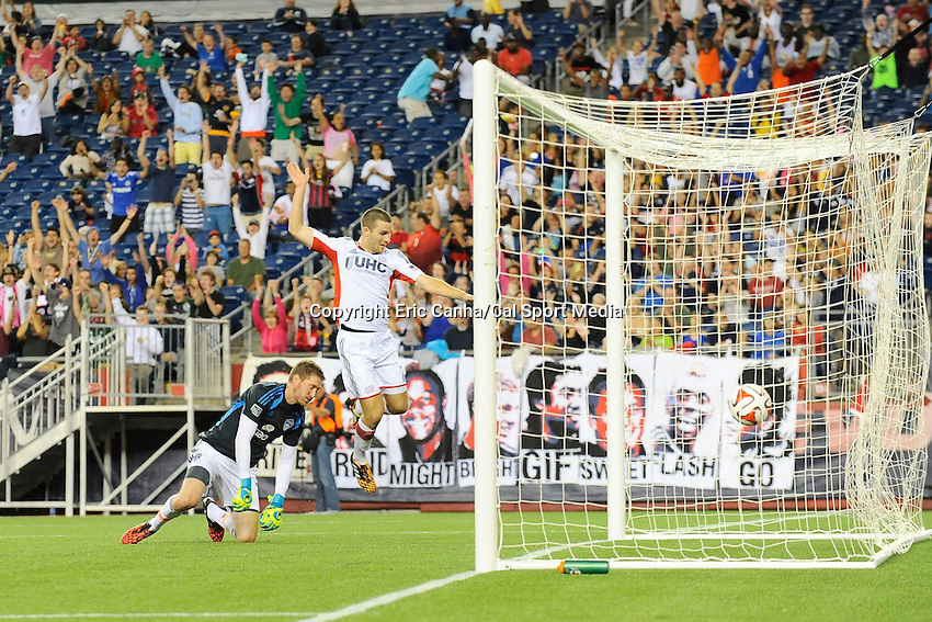 July 30, 2014 - Foxborough, Massachusetts, U.S. - New England Revolution's Patrick Mullins (7) points to the ball in the back of the net as Colorado Rapids' goalkeeper Clint Irwin (1) gets up during the MLS game between the Colorado Rapids and the New England Revolution held at Gillette Stadium in Foxborough Massachusetts. The New England Revolution defeated the Colorado Rapids 3-0. Eric Canha/CSM