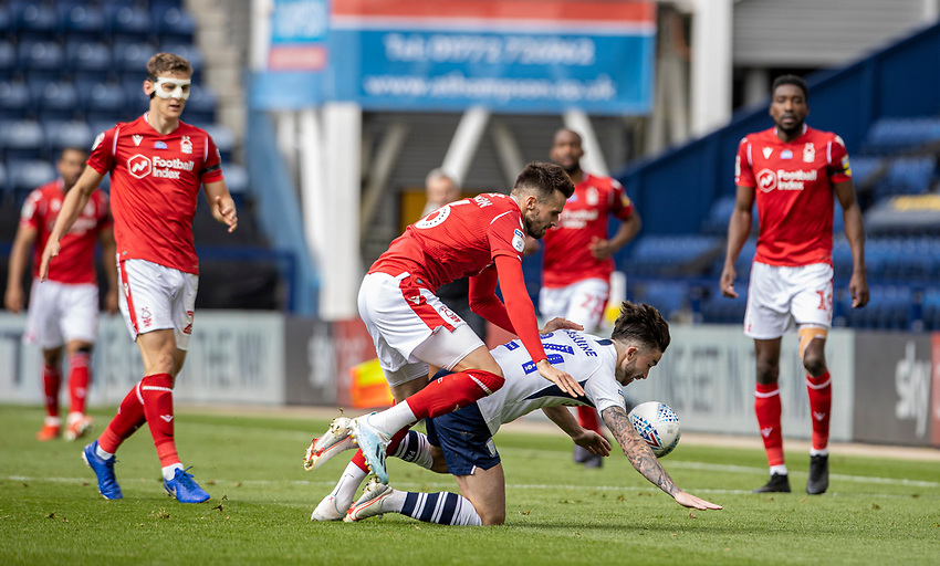 Preston North End's Sean Maguire (right) competing with Nottingham Forest's Carl Jenkinson <br /> <br /> Photographer Andrew Kearns/CameraSport<br /> <br /> The EFL Sky Bet Championship - Preston North End v Nottingham Forest - Saturday 11th July 2020 - Deepdale Stadium - Preston <br /> <br /> World Copyright © 2020 CameraSport. All rights reserved. 43 Linden Ave. Countesthorpe. Leicester. England. LE8 5PG - Tel: +44 (0) 116 277 4147 - admin@camerasport.com - www.camerasport.com