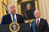 Attorney General Jeff Sessions (R) listens to U.S. President Donald J. Trump (L) speak before Vice President Mike Pence swore Sessions in as the next attorney general in the Oval Office of the White House in Washington, DC, USA, 09 February 2017. On 08 February, after a contentious battle on party lines, the Senate voted to confirm Sessions as attorney general.<br /> Credit: Jim LoScalzo / Pool via CNP