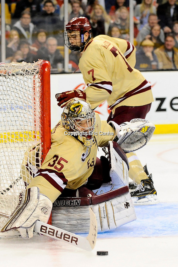 Boston College goaltender Parker Milner (35) makes a stick save during the championship round of the Beanpot Tournament hockey between Boston College and Northeastern University held at TD Garden in Boston Massachusetts.  Eric Canha/CSM
