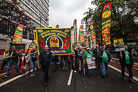 Steve Hedley (RMT Assistant General Secretary).<br /> <br /> London, 01/05/2014. Thousands of people marched in central London to celebrate the International Workers' Day dedicated this year to the two great leaders, Bob Crow (General Secretary & leader of the Rail Maritime and Transport Union, RMT) and Tony Benn (Former Labour Cabinet Minister, Socialist and leading left-wing and anti-war campaigner), both passed away in March 2014. The rally started in Clerkenwell Green and ended in Trafalgar Square where speakers gave speeches remembering the two late leaders, in defence of worker's rights, in protest against the coalition Government spending cuts and policies, and in support and solidarity with the other demonstrations held around the world.
