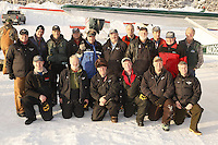 "February 16, 2013 Volunteer Iditarod Air force pilots pose for a photo at the Willow airport during the first day of the ""Food Fly"" activities.  This is where musher's food bags, straw, HEET and people food is flown by the Iditarod Air Force to the 4 checkpoints on the east side the Alaska Range. ..Photo Copyright Jeff Schultz  -- Do not reproduce without written permission"