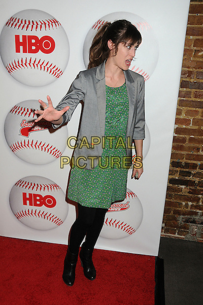 "Lizzy Caplan.HBO's ""Eastbound And Down"" Season 3 Premiere held at Cinespace, Hollywood, California, USA..February 9th, 2012.full length top blazer grey gray green dress black tights hand arm profile mouth open.CAP/ADM/BP.©Byron Purvis/AdMedia/Capital Pictures."