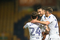 Max Muller (centre) of Wycombe Wanderers congratulates Scott Kashket of Wycombe Wanderers on his goal during the The Checkatrade Trophy  Quarter Final match between Mansfield Town and Wycombe Wanderers at the One Call Stadium, Mansfield, England on 24 January 2017. Photo by Andy Rowland.