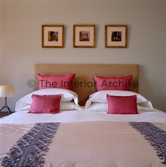 A traditional Egyptian bedcover with intricate embroidery covers the bed in the master bedroom