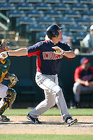 Cord Phelps of the Cleveland Indians bats against the Oakland Athletics in a spring training game at Phoenix Municipal Stadium on March 2, 2011  in Phoenix, Arizona. .Photo by:  Bill Mitchell/Four Seam Images.