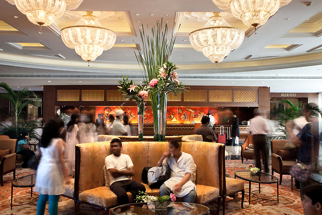 MUMBAI, INDIA - SEPTEMBER 27, 2010: The bustling lobby in the  renovated Taj Mahal Palace and Tower Hotel in Mumbai. The Hotel has re-opened after the terror attacks of 2008 destroyed much of the heritage wing. The wing has been renovated and the hotel is once again the shining jewel of Mumbai. pic Graham Crouch