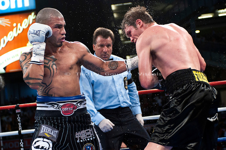 Bronx, NY - 06.05.2010: Miguel Cotto lands on Yuri Foreman during their WBA Jr. middleweight championship fight at Yankee Stadium on Saturday June 5th, 2010. Cotto won the belt from Foreman by a ninth-round TKO. Photo by Thierry Gourjon