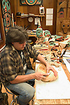 alaska10912 Alaska, Sitka.  Carver of wood, model released, at Sitka National Historic site..Photo copyright Lee Foster, 510/549-2202, lee@fostertravel.com, www.fostertravel.com.