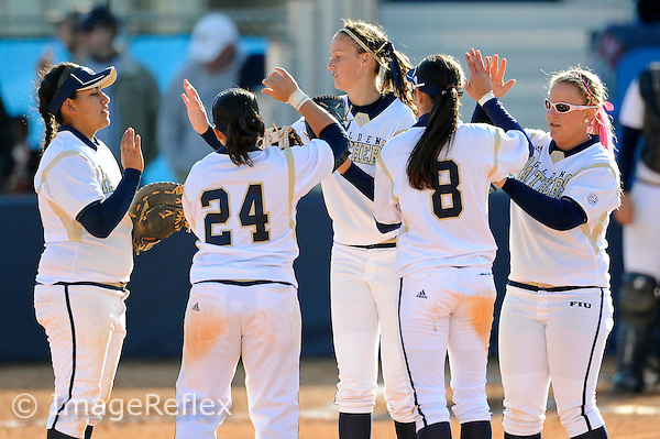 13 February 2010:  FIU's Kasey Barrett (5)(center) high-fives with teammates as the FIU Golden Panthers defeated the Southern Illinois Salukis, 10-6, at the University Park Stadium in Miami, Florida.