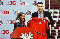 Kevin McGuff, right, smiles with Miechelle Willis, left, executive associate athletics director, during a press conference announcing McGuff as the new head coach of the Ohio State University women's basketball team at Value City Arena in Columbus, Wednesday afternoon, April 17, 2013. Replacing Jim Foster, McGuff comes to OSU after two years at the University of Washington where his team went 41-26 with two berths in the WNIT. Previous to that he was head coach  at Xavier University for nine years. (The Columbus Dispatch / Eamon Queeney)