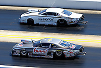 Sep 14, 2013; Charlotte, NC, USA; NHRA pro stock driver Jason Line (near) races alongside Shane Gray during qualifying for the Carolina Nationals at zMax Dragway. Mandatory Credit: Mark J. Rebilas-