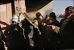 Crowds examine the torture apparatus in a house formerly used by SAVAK.  December 31, 1978