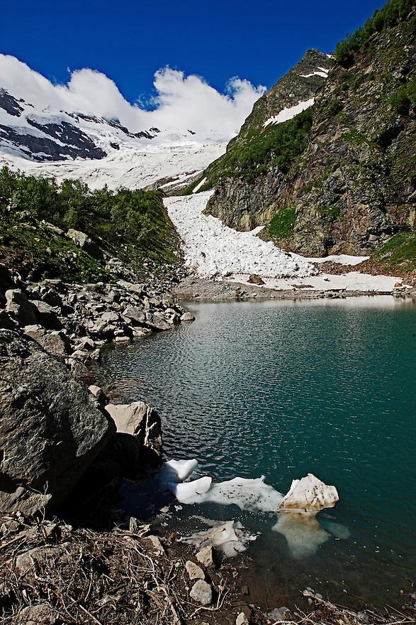 Russia, Caucasus, Teberdinsky Biosphere reserve, Turye Lake in Alibek valley near Dombay. Alibek glacier behind.