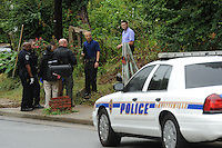 NWA Democrat-Gazette/ANDY SHUPE<br /> Fayetteville Police Department personnel gather Wednesday, Aug. 19, 2015, outside a house at 433 S. Hill Ave. after a caller reported a death at the residence.