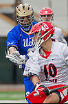 Orange, CA 03-05-17 - Hunter So (Chapman #40) and Derek Hankim (UCLA #6) in action during the UCLA - Champman Southern Lacrosse Conference MCLA Division 1 Men's Lacrosse game.
