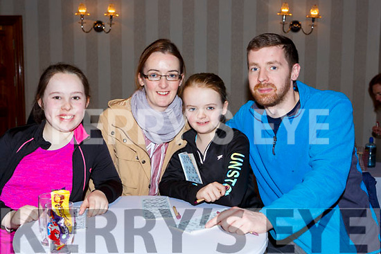 Ticking the numbers at the Gaelscoil Faitleann bingo in the Gleneagle Hotel on Sunday l-r: Gace O'Shea, Jenny Friel, Feithleann and Kieran Somers
