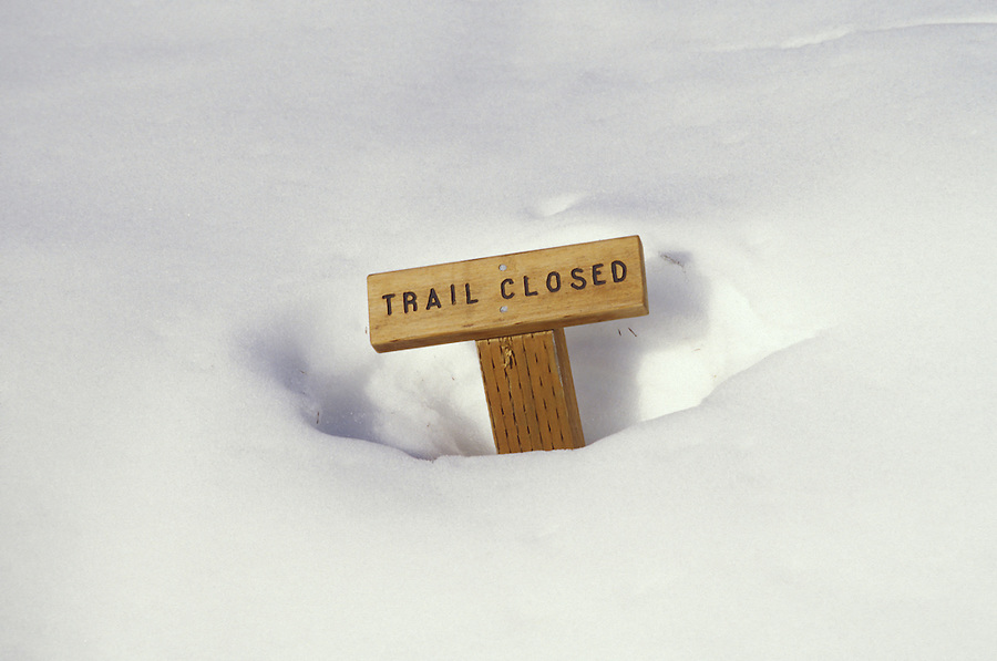 Trail Closed sign buried in snow, Park Butte Lookout Trail, Mt Baker National Recreation Area, Cascade Mountains, Washington