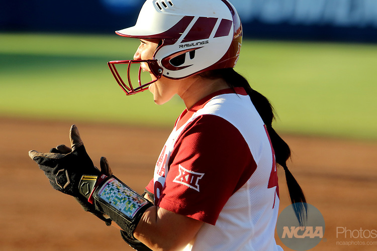 06 JUNE 2016: Erin Miller (48) of University of Oklahoma reacts after reaching base safely against Auburn University during the Division I Women's Softball Championship held at ASA Hall of Fame Stadium in Oklahoma City, OK.  University of Oklahoma defeated Auburn University in Game 1 by the final score of 3-2. Shane Bevel/NCAA Photos