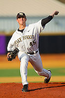 Starting pitcher Brian Holmes #45 of the Wake Forest Demon Deacons delivers a pitch to the plate against the Charlotte 49ers at Gene Hooks Field on March 22, 2011 in Winston-Salem, North Carolina.   Photo by Brian Westerholt / Four Seam Images