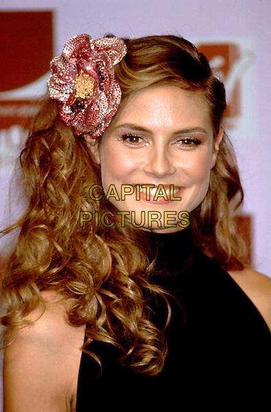 HEIDI KLUM.MTV Awards.headshot, portrait. flower, hair accessory, curls,.www.capitalpictures.com.sales@capitalpictures.com.©Capital Pictures