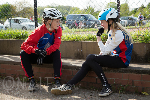 10 MAY 2015 - GREAT BLAKENHAM, GBR - 2012 European and British champion Lauren Jacobs (left) of Ipswich Eagles Cycle Speedway Club offers advice to team mate Chloe Pearce during the South East 2 League fixture against Great Blakenham at Great Blakenham, Suffolk, Great Britain (PHOTO COPYRIGHT © 2015 NIGEL FARROW, ALL RIGHTS RESERVED)
