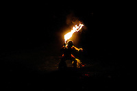 Polynesian fire dancer in Hawaii