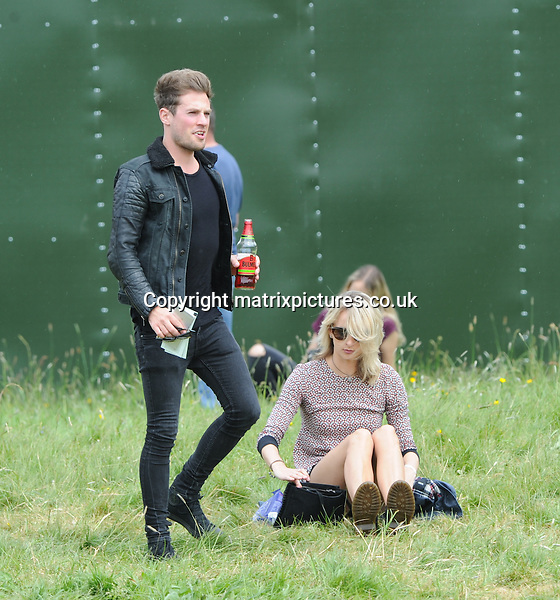 NON EXCLUSIVE PICTURE: MATRIXPICTURES.CO.UK<br /> PLEASE CREDIT ALL USES<br /> <br /> WORLD RIGHTS<br /> <br /> British drummer from a boy band Lawson, Adam Pitts is pictured with a mystery blonde at Radio 1's Big Weekend at Earlham Park, Norwich, Norfolk.<br /> <br /> MAY 23rd 2015<br /> <br /> REF: SFL  151650