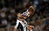 Calcio, Tim Cup: finale Juventus vs Lazio. Roma, stadio Olimpico, 17 maggio 2017.<br /> Juventus&rsquo; Andrea Barzagli, left, and Lazio's Ciro Immobile jump for the ball during the Italian Cup football final match between Juventus and Lazio at Rome's Olympic stadium, 17 May 2017.<br /> UPDATE IMAGES PRESS/Isabella Bonotto
