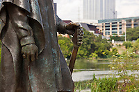 The statue of Stevie Ray Vaughan stands on the shores of Lady Bird Lake.
