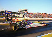 Aug 15, 2014; Brainerd, MN, USA; NHRA top fuel dragster driver Antron Brown (near lane) races alongside Doug Kalitta during qualifying for the Lucas Oil Nationals at Brainerd International Raceway. Mandatory Credit: Mark J. Rebilas-